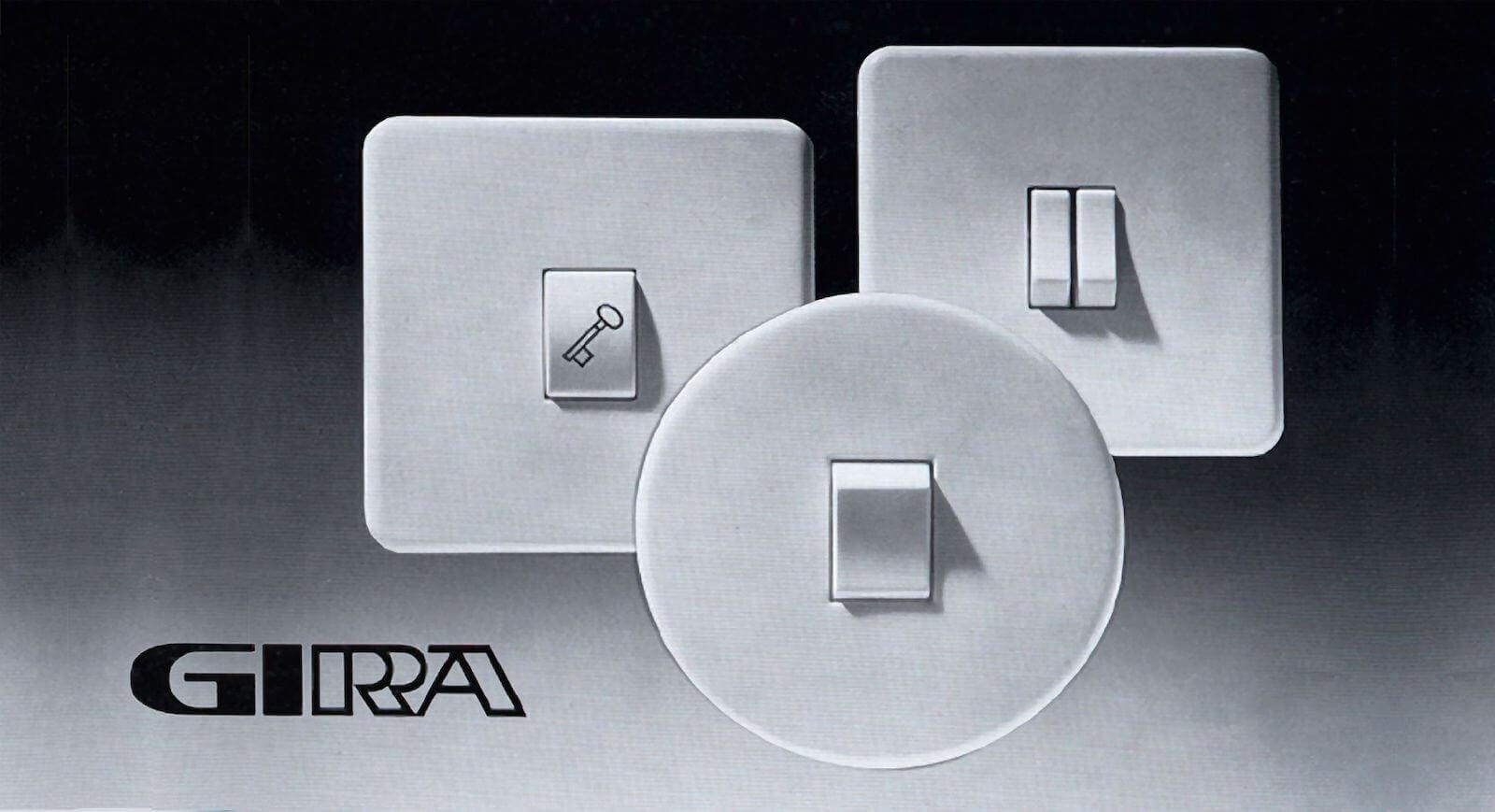 Firmenlogo Gira neben weißen Schalterprogrammen