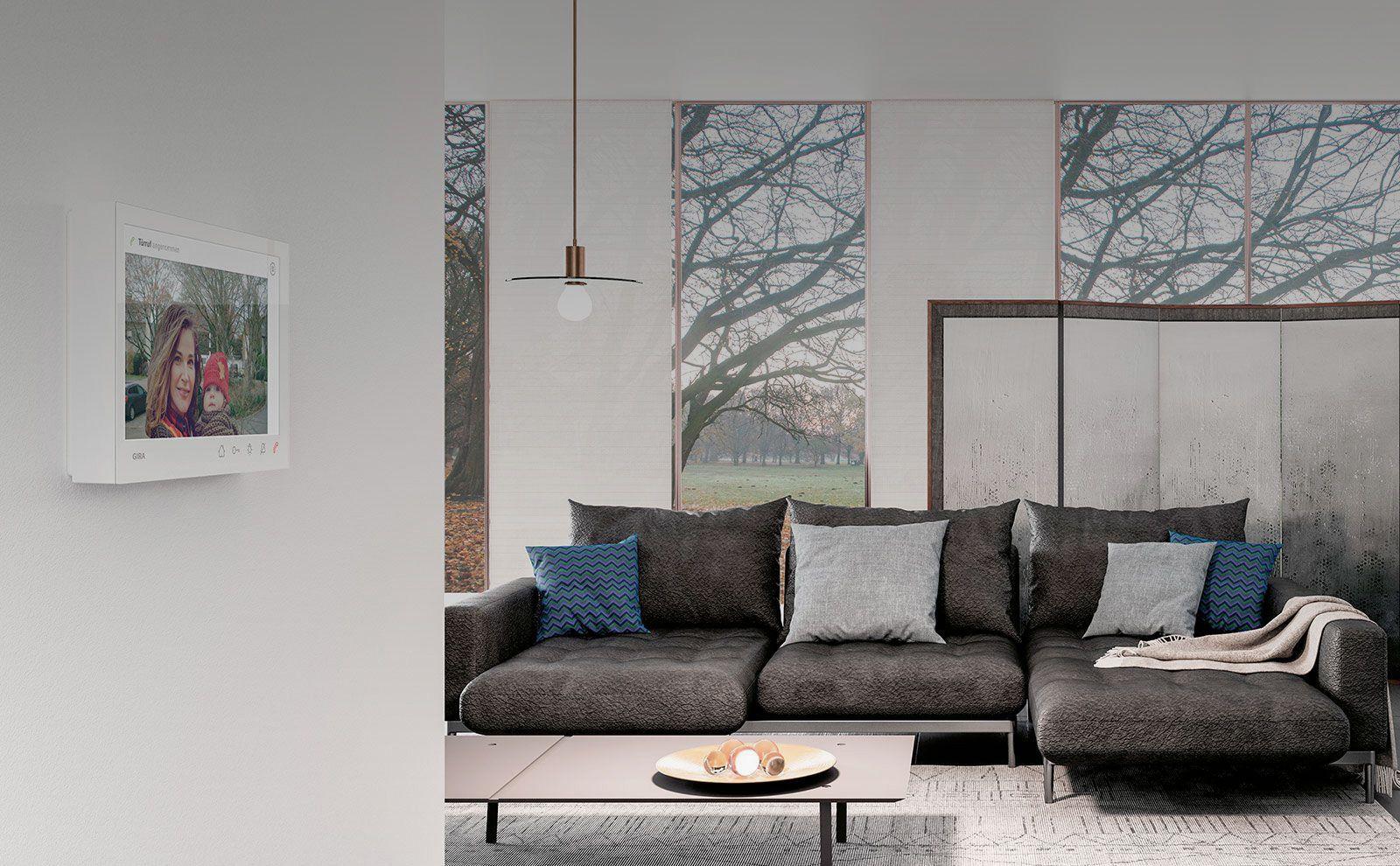 Gira Wohnungsstation Video AP 7 in weiß im Wohnzimmer Randering