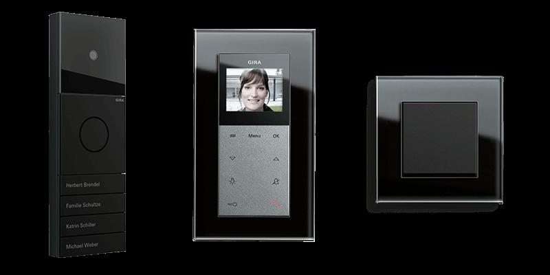 Gira System 106 Türkommunikation, Wohnungsstation und Schalter mit Gira Esprit Glas Schwarz